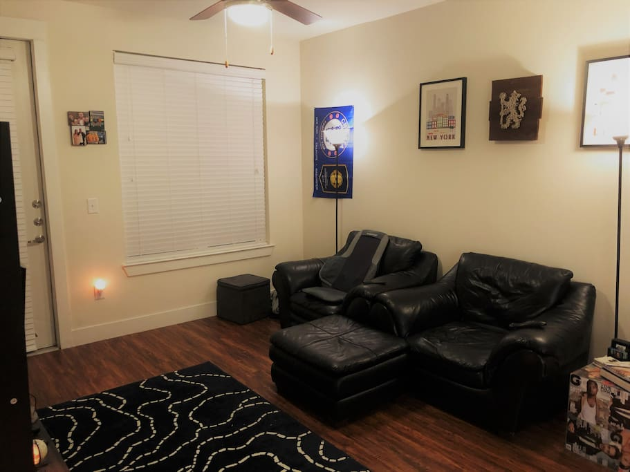 Living Room seating arrangement with ottoman and massage chair.