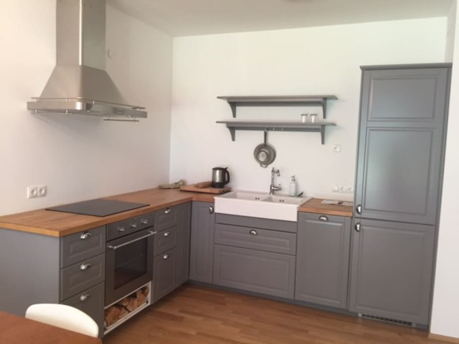 Country-house style kitchen including all amenities you need (dishwasher, fridge, freezer, plates, cutlery, pots, water kettle)