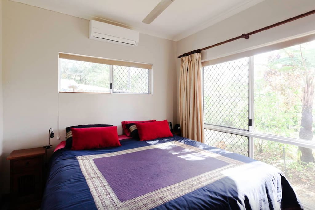 King sized bedroom with screens and air-conditioning.