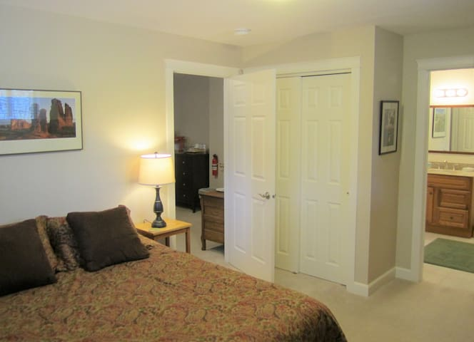 Bedroom w/queen bed.  Picture also shows doors to private bath and private living room.