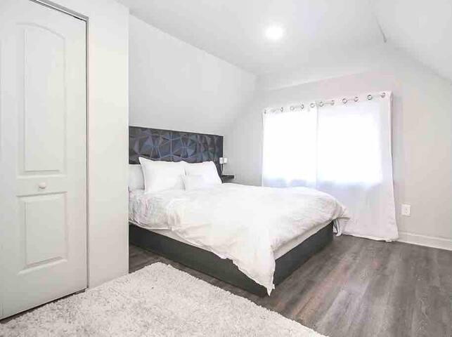 Bedroom includes a 46 inch flatscreen smart tv.