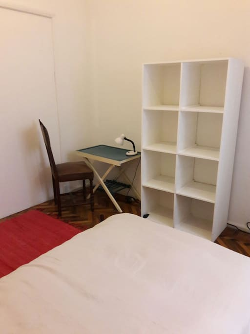 Matrimonial room.  One and a half size bed, desk, wordrobe and mirror. Size:  10 square meters. It counts with a window facing to the building air pocket.