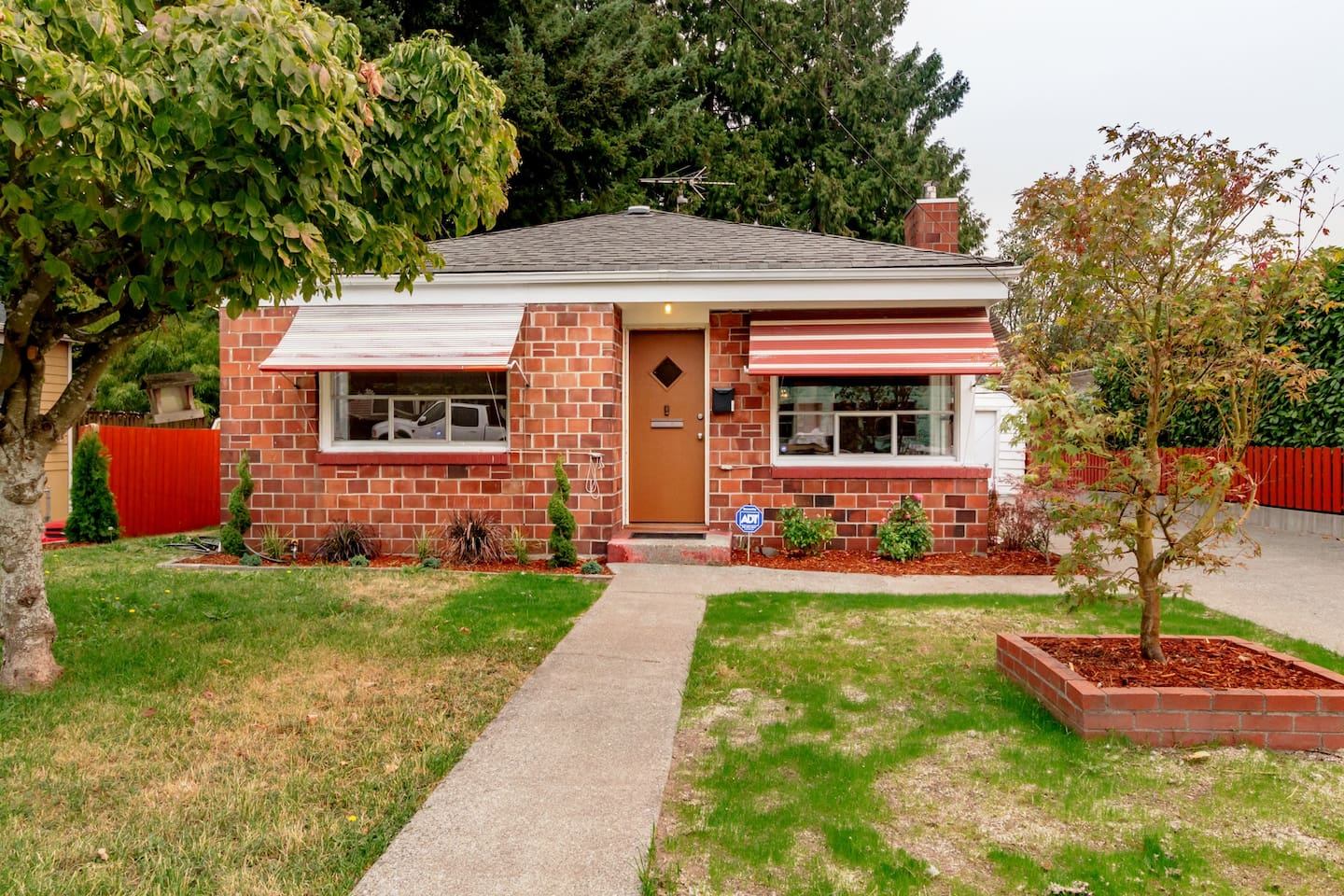 1 Story Brick Rambler with detached garage and 3 car off street parking.