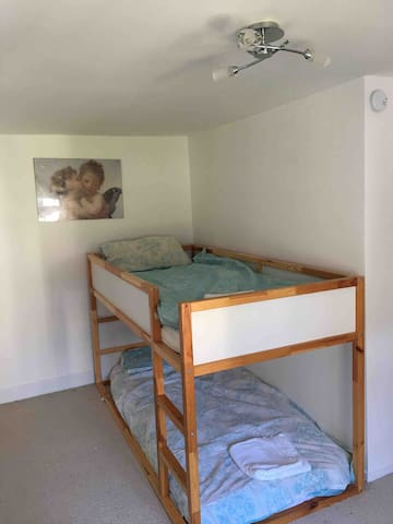 Second bedroom. This is a cabin style bunk bed suitable for children and not adults.