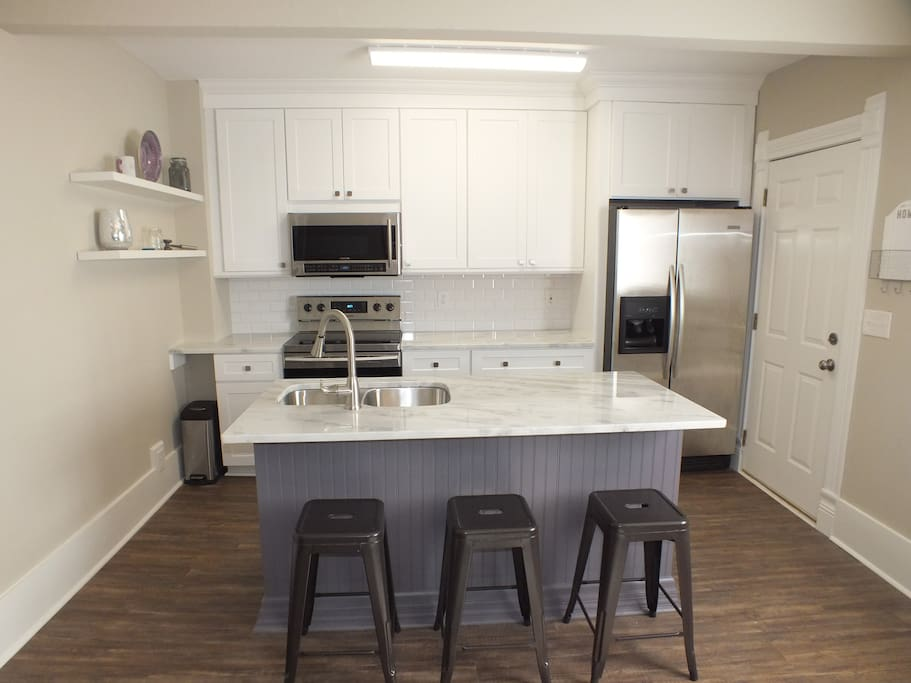 Another angle of the kitchen.  Unit includes Stainless Steel appliances, new cabinets, granite countertops, and more!