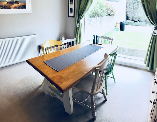 A lounge-dining room with up-cycled furniture