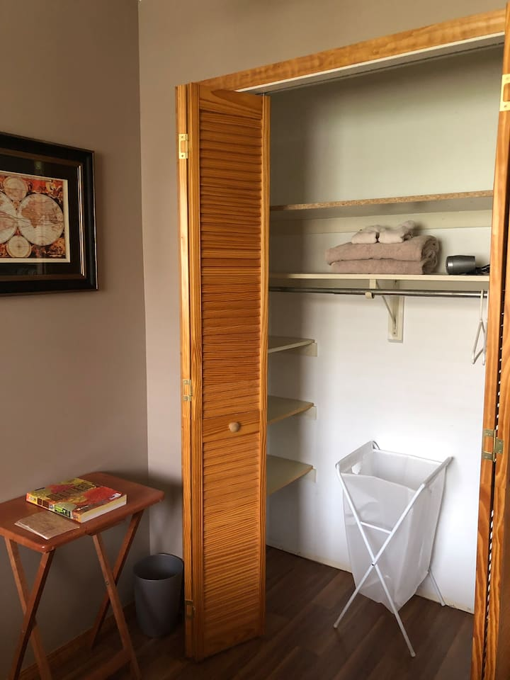 Large closet space with plenty of shelves, clothes hangers, luggage rack and laundry hamper to accommodate a guests belongings easily and efficiently.