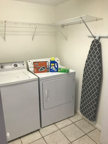 Updated laundry room with a ironing  board & laundry detergent included
