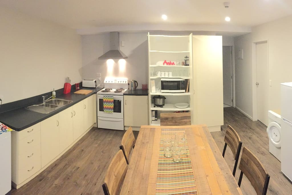Fully equipped kitchen and dining table seats 6