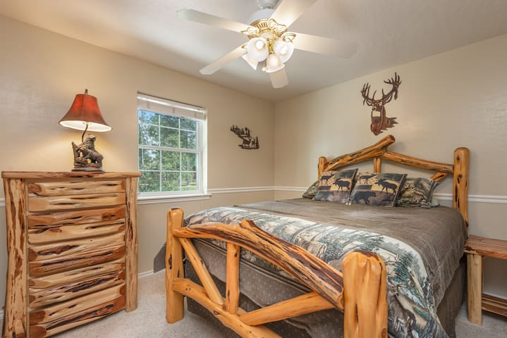 Rustic and charming, bedroom #2 features a queen bed and plenty of room for your belongings.