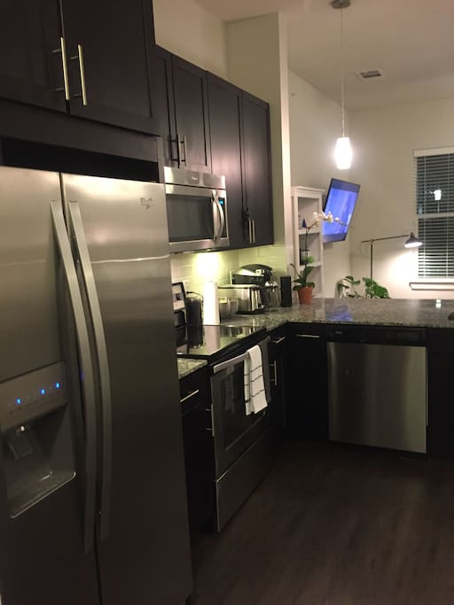 Brand new stainless steel appliances, HE washer and dryer (not pictured)