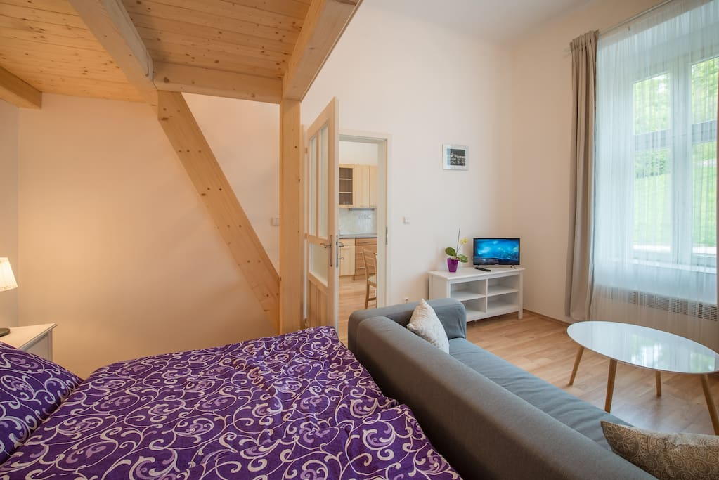 Comfy bed that you can enjoy after your day-long walks in historic city centre, the grey curtains will allow you to have undisturbed sleep.