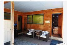 Outside the communal area. Here you'll find the bathroom and laundry with washer, drier and fridge freezer. There are also power points here where you can charge devices. Remember there is only solar lighting in the cabin