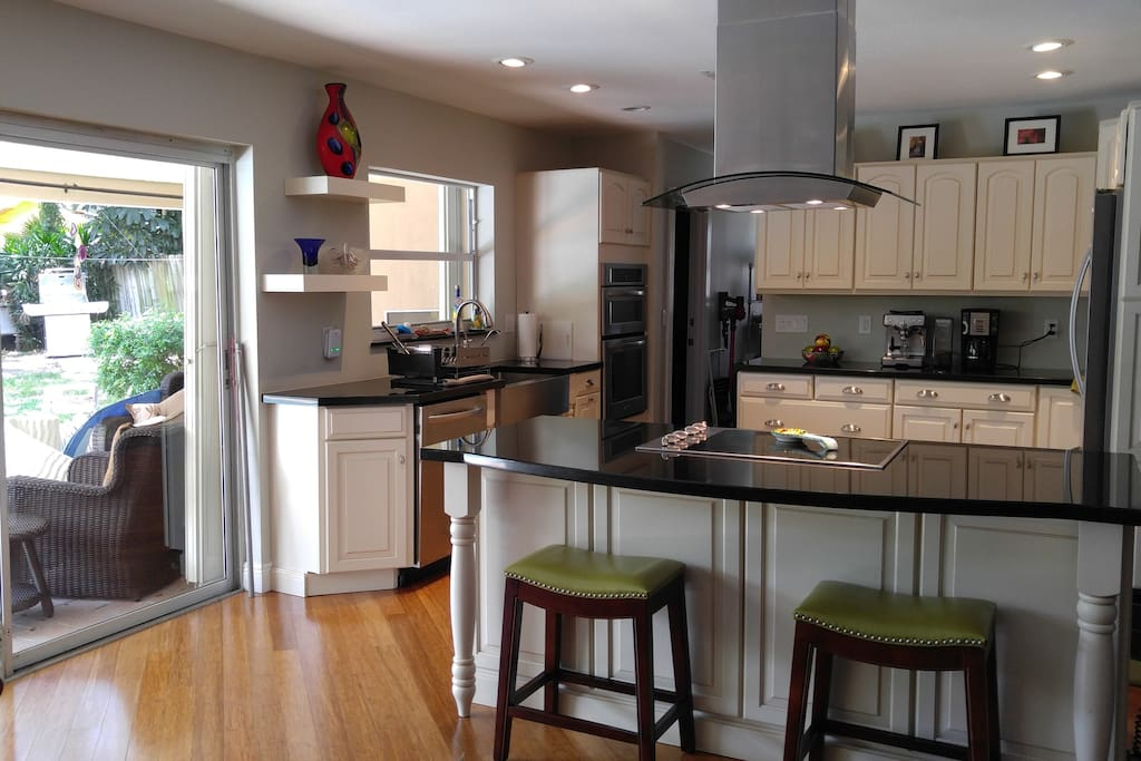Great Chef's Kitchen is open to the living area and overlooks the pool area.