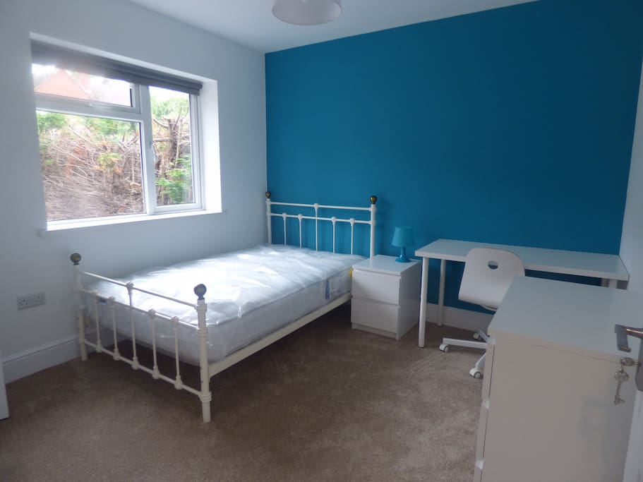 One of the six spacious double bedrooms