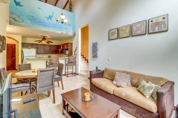 Breezy condo with shared pool only a quick walk from the beach!