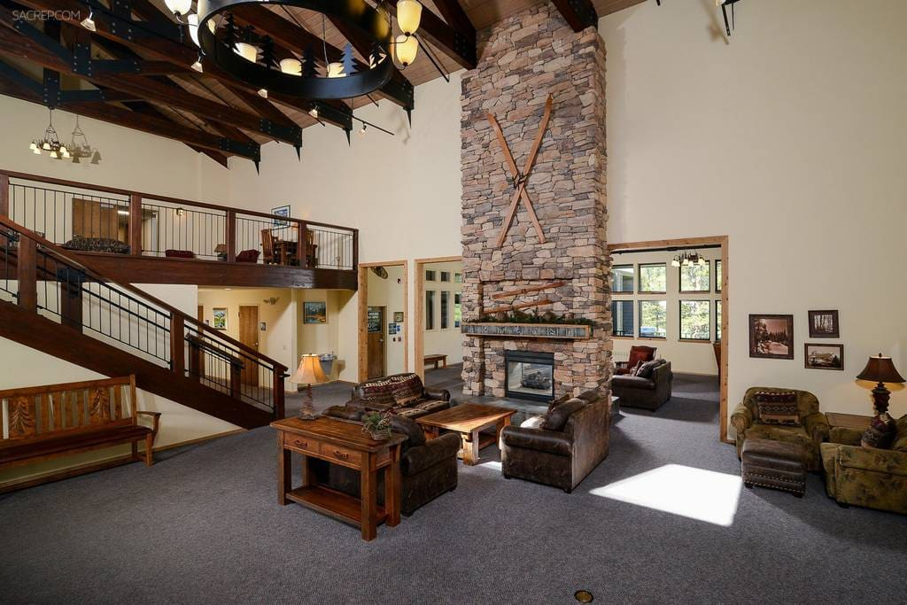 Part of the commons area, featuring comfortable seating for relaxation and a cozy fireplace to warm up by after a day on the slopes