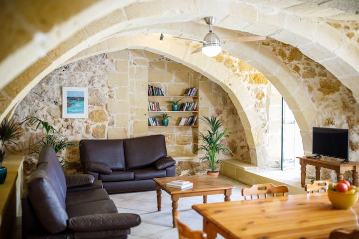Beautiful living and dining area set under traditional Maltese arches - this room is over 200 years old.