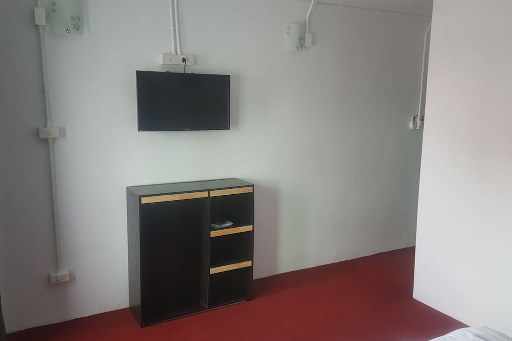 Double room TV and clothes storage