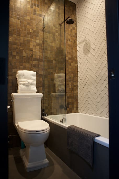 Your priviate modern full bathroom, right off the living room. Huge tub - bubble bath city!