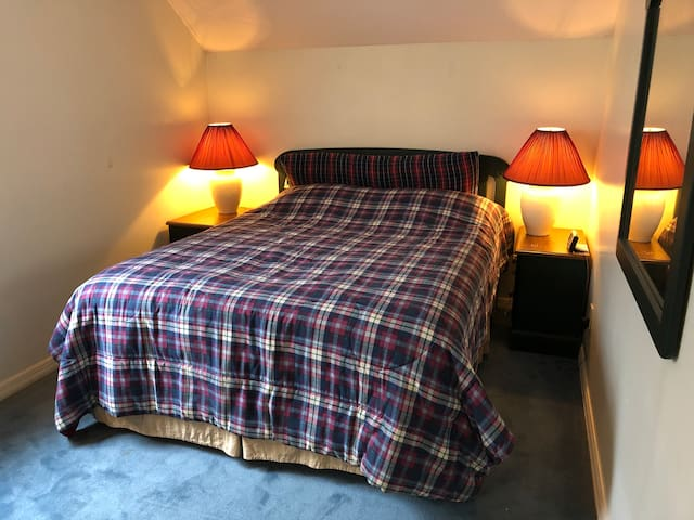 Bedroom with a comfortable queen size bed