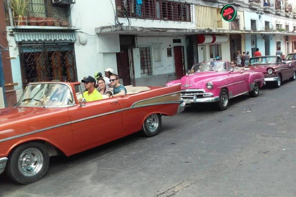 Industria Street, where traditional cars parade, strolling through the Capitol of Havana to the Habanero Malecon.