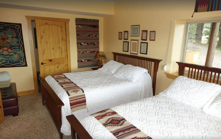 Moose Ridge. Second lower floor bedroom with 2 queens and a full bathroom