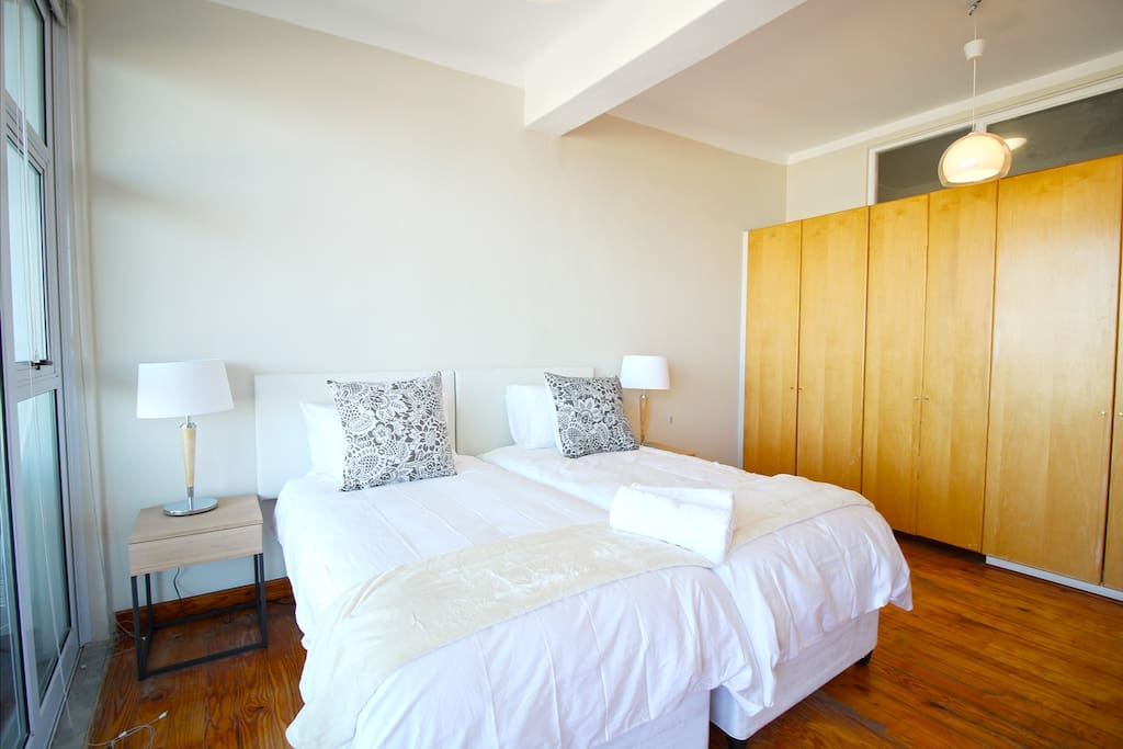 Main bedroom with 2 single beds that can be pushed together or separated, plenty of cupboard space