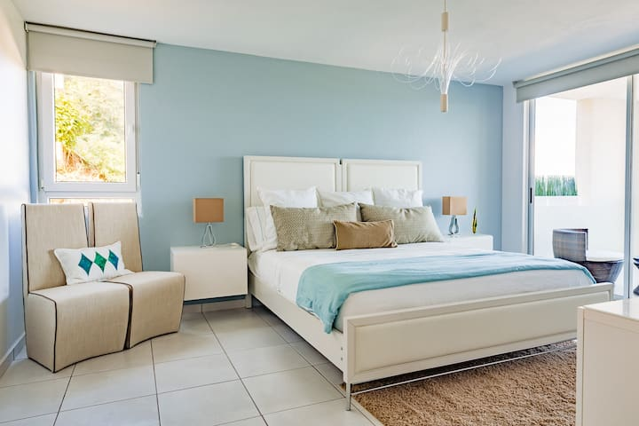 This is bedroom three the master bedroom which has a king size bed that sleeps two comfortably a television a walk-in closet with bathrobes, bath towels and beach towels and beach quilt for two and an en suite private bathroom and ocean views.