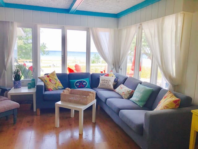 Living room with gorgeous look out to the lake
