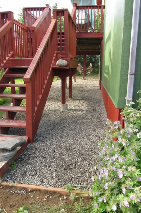 Gravel patio and second story deck.