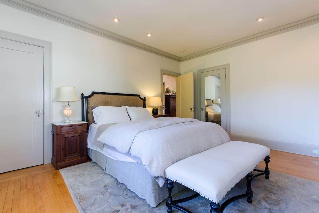 Queen-size bed with Tempurpedic mattress in master bedroom