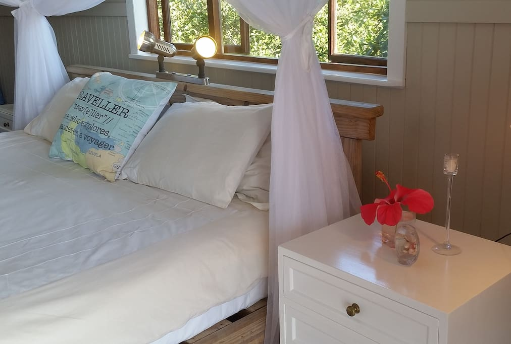 Spacious air-conditioned main bedroom en suite.  Stunning sea views from your king size bed.
