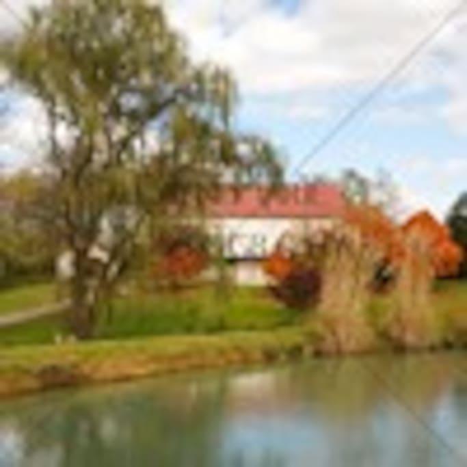 Beautiful Country Estate w/pond, bridge, hiking trail, adjoins park