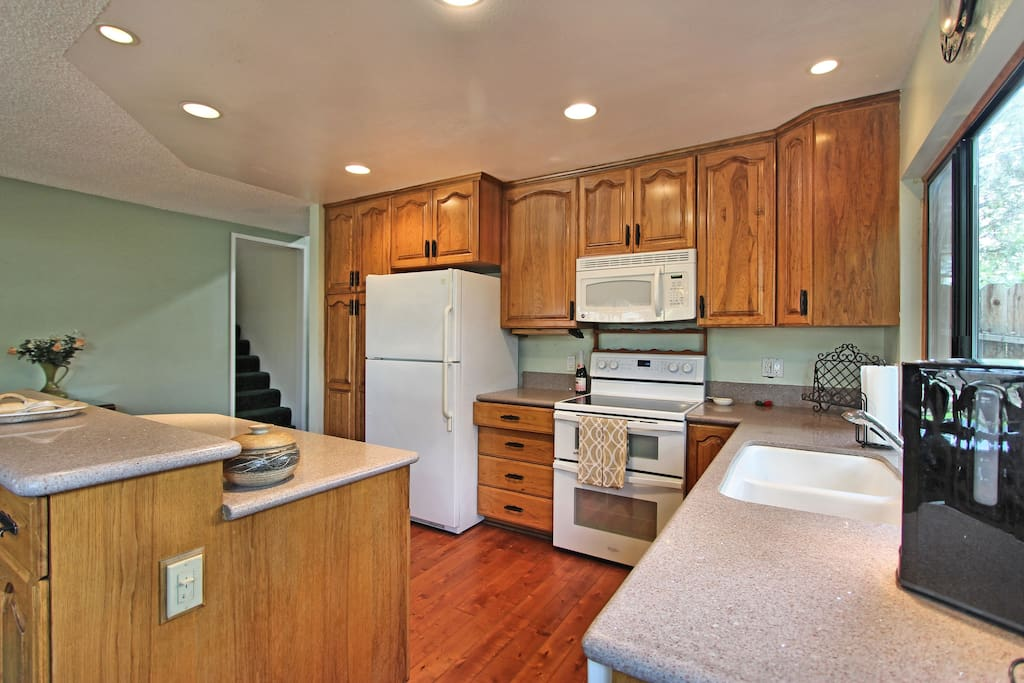 Lots of counters, a microwave, and dishwasher