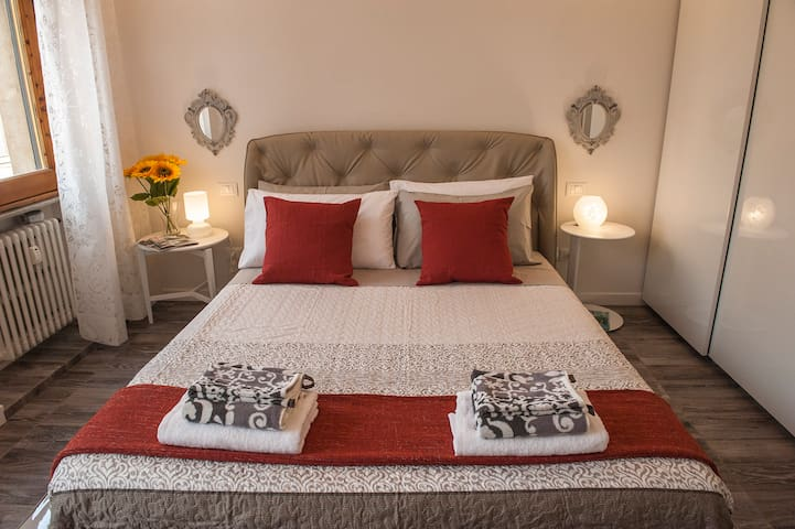 an italian design king size bed will guarantee our guests a beautiful sleep on a memory foam mattress with double pillows and white cotton sheets.....