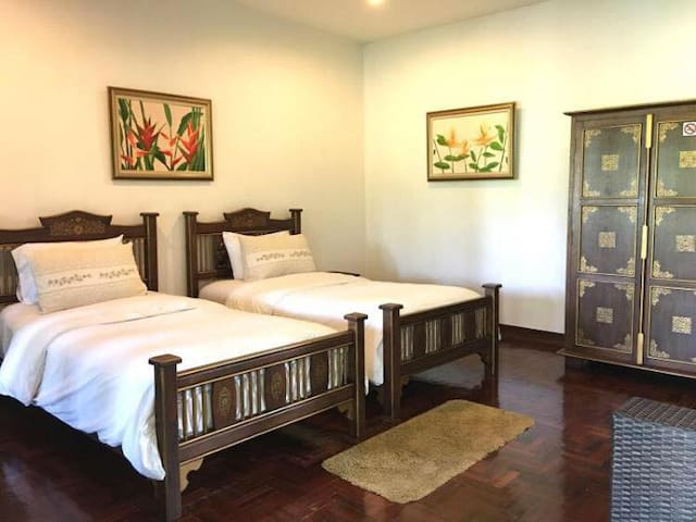 Twin bed with private balcony by the ping river