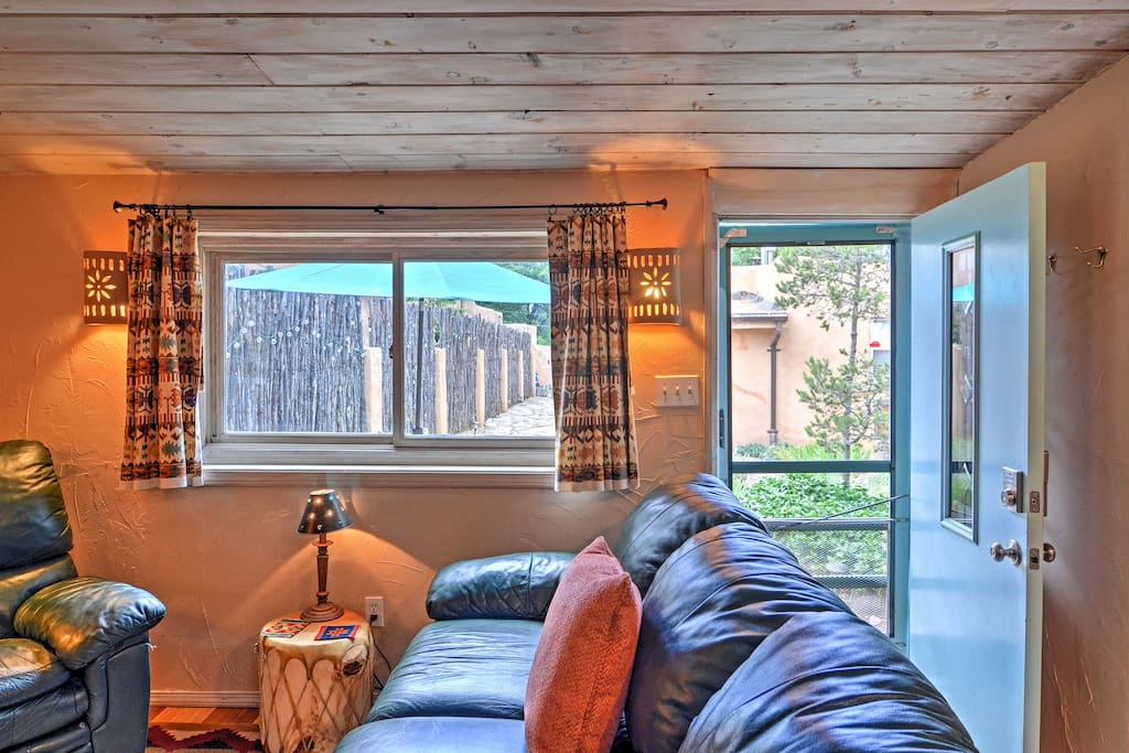 Relax on the plush sofa and read your favorite book while occasionally glancing out the window to admire the peaceful New Mexico view.