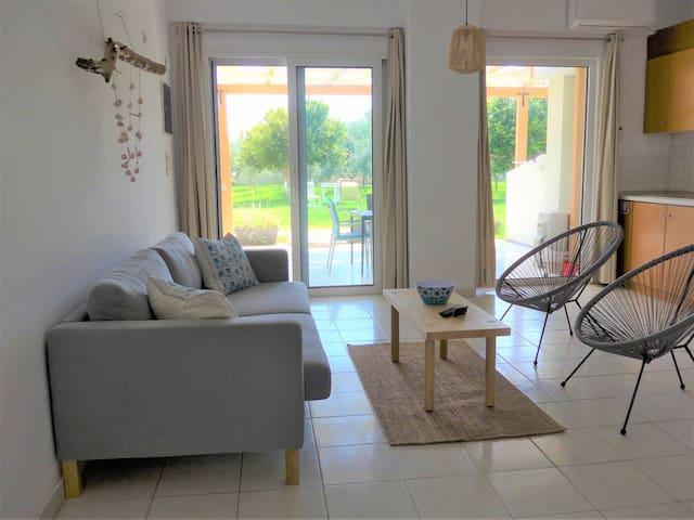 Open plan living room and kitchen with  windows /sliding door