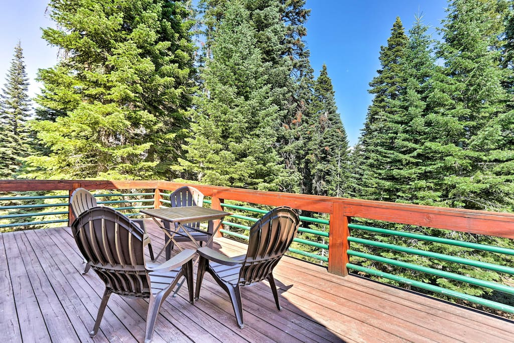 Enjoy scenic views from the large private deck of this vacation rental!