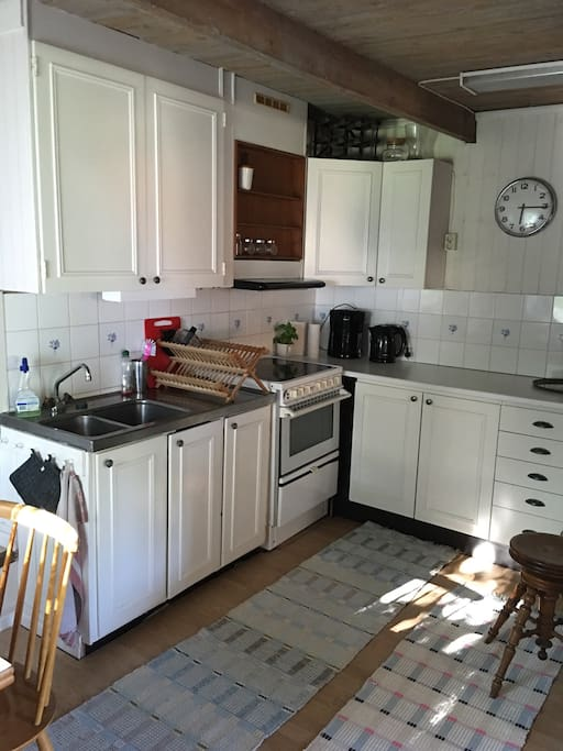 Kitchen with fridge, coffemaker, stove and oven.