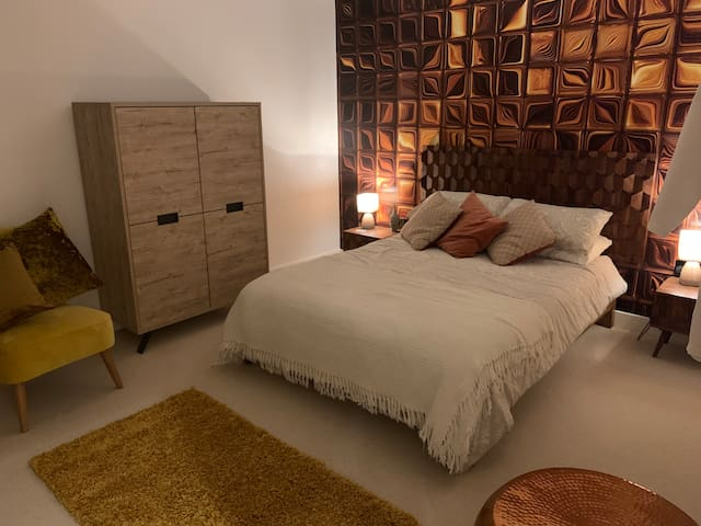 'Air', stylish and modern room with king size bed.
