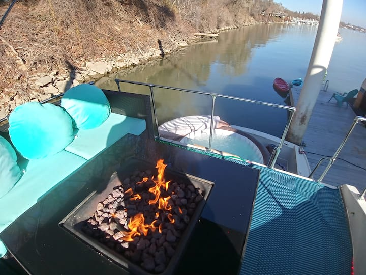 Yacht with hot tub and a firepit overlooking river