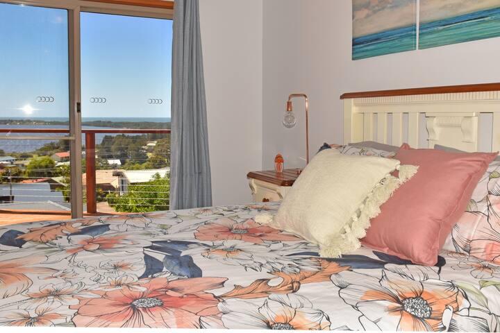 Awaken to water views - Master Bedroom with deck access