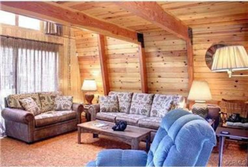 Another pic of the living room that shows the sliding doors out to the front deck! As mentioned the living room comes complete with sofa bed, love seat, recliner, fireplace, Hi Definition Cable TV, DVD/VCR player and Wifi included.