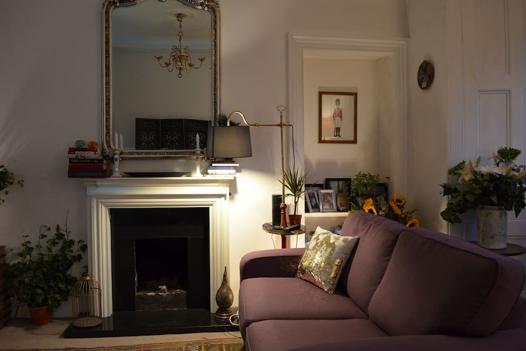 Living Room (Common Area). Please note: this sofa is also a sofa bed that is made available only to three-person bookings.