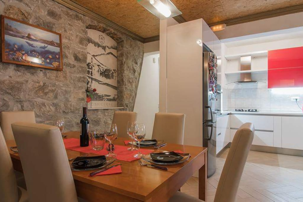 Old dalmatian house walls connected with modern furniture make this apartment interesting