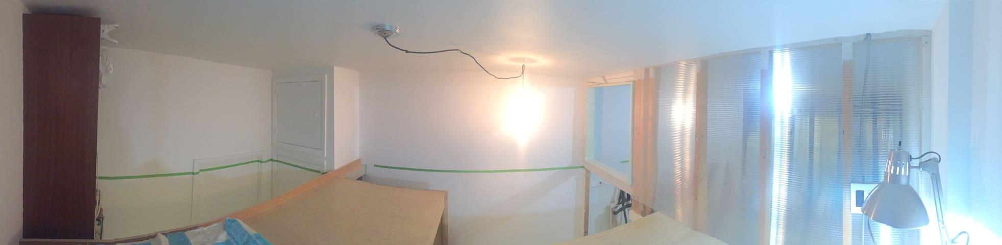 Semi private room with sleeping loft.