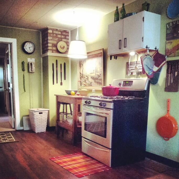 Inside, past the mudroom, is the kitchen.