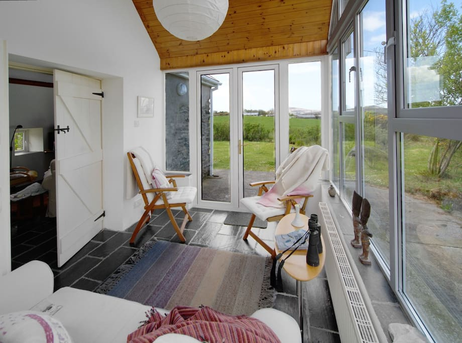 The sunroom leads to a private garden - the perfect place to watch the sun setting over Dunmanus Bay